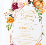 Close up of Lux Party's little pumpkin baby shower invitation with fall flowers and gold lettering, on top of a white envelope.