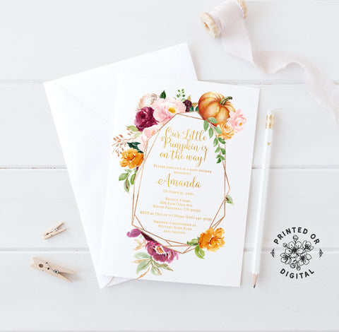 Lux Party's little pumpkin baby shower invitation with fall flowers and gold lettering, on top of a white envelope.