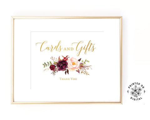 Lux Party's cards and gifts sign, with gold lettering and maroon and pink flowers, in a gold frame.