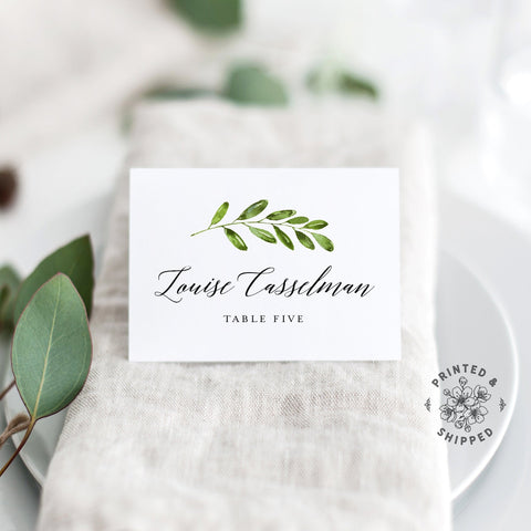 Lux Party's greenery place cards with white background and black lettering, in a wedding table place setting.
