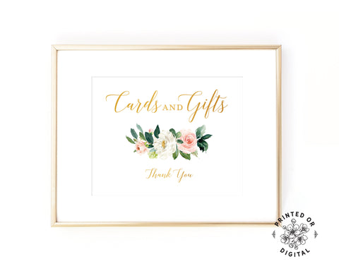 Lux Party's cards and gifts sign, with gold lettering and pastel flowers, in a gold frame.