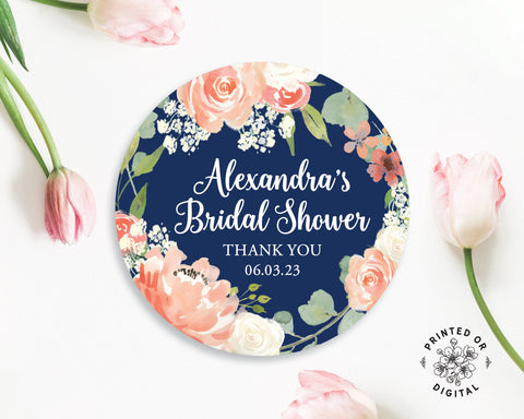 Lux Party's round personalized bridal shower sticker with navy blue and floral background, surrounded by pink tulips.