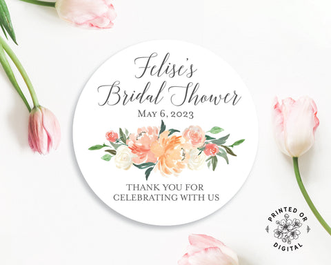 Lux Party's round personalized bridal shower sticker with pastel florals and dark grey text, surrounded by pink tulips.
