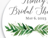 Close up of Lux Party's round bridal shower sticker with a greenery sprig and dark grey text.