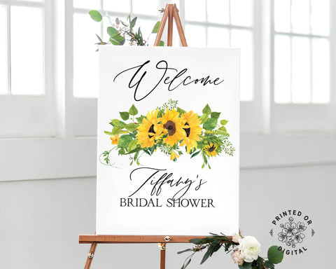 Lux Party's bridal shower welcome sign, with sunflowers and black lettering, on a wooden easel.