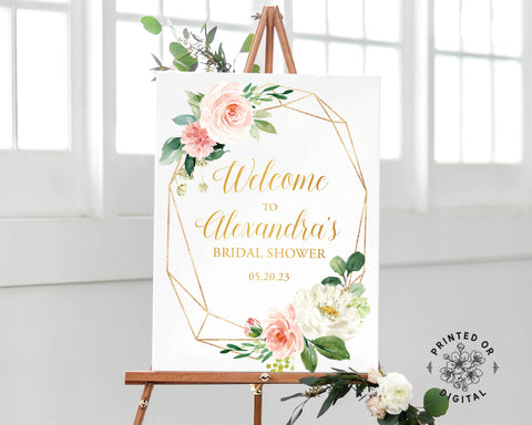 Lux Party's bridal shower welcome sign, with pastel flowers and gold lettering, on a wooden easel.