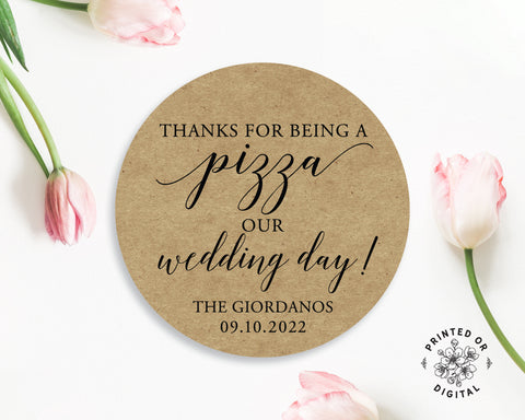 Lux Party's round thanks for being a pizza our wedding day personalized sticker with brown kraft background surrounded by pink tulips.