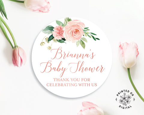 Lux Party's round baby shower stickers with pink flowers and pink text, surrounded by pink tulips.