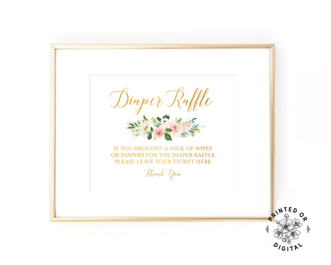 Lux Party's diaper raffle sign, with gold lettering and pastel flowers, in a gold frame.