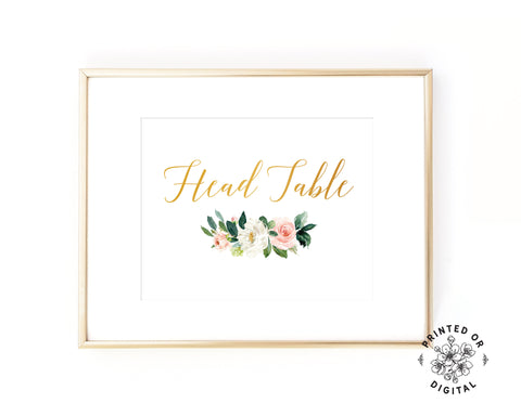 Lux Party's head table sign, with gold lettering and pastel flowers, in a gold frame.