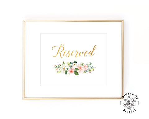 Lux Party's reserved sign, with gold lettering and pastel flowers, in a gold frame.