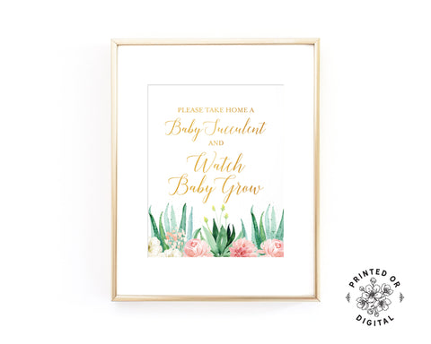 Lux Party's baby succulent baby shower sign, gold lettering, pastel flowers, and succulents, in a gold frame.