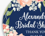 Close up of Lux Party's round personalized bridal shower sticker with navy blue and floral background.