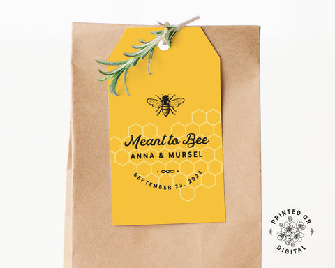Lux Party's yellow meant to bee wedding favor tag with black lettering, affixed to a brown kraft favor bag.