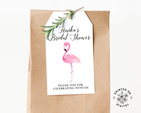 Lux Party's white flamingo bridal shower favor tag with black lettering, affixed to a brown kraft favor bag.