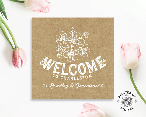 Lux Party's square personalized welcome sticker with white text and a brown kraft background, surrounded by pink tulips.