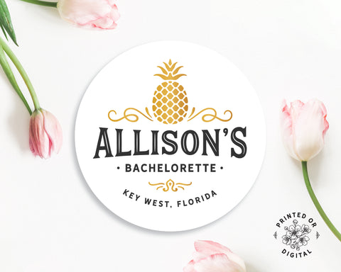 Lux Party's round personalized bachelorette sticker with black text and a gold pineapple, surrounded by pink tulips.