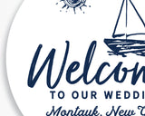 Close up of Lux Party's round personalized welcome to our wedding sticker with a white background and navy blue beach theme.
