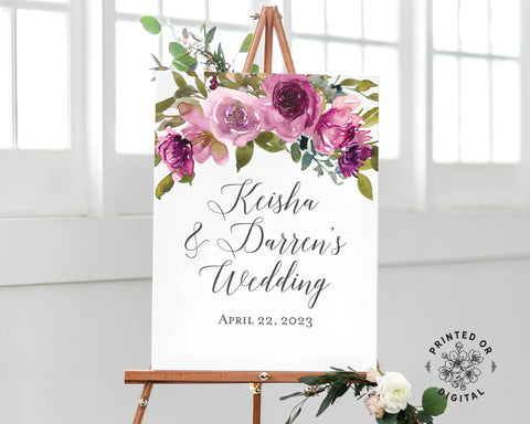 Lux Party's wedding welcome sign, with purple flowers and dark grey lettering, on a wooden easel.