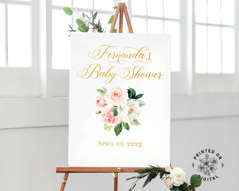 Lux Party's baby shower welcome sign, with pastel flowers and gold lettering, on a wooden easel.