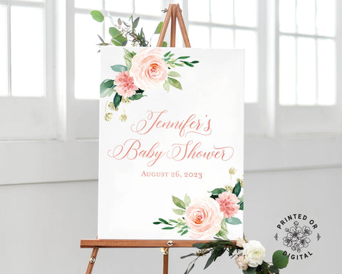 Lux Party's baby shower welcome sign, with pink flowers and pink lettering, on a wooden easel.