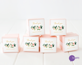 Six pink favor boxes with floral and gold thank you stickers affixed. Lux Party logo.