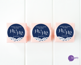Three pink favor boxes with round navy blue and white lace Mr. & Mrs. wedding stickers affixed. Lux Party logo.
