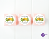 Three pink favor boxes with round let love grow sunflower wedding stickers affixed. Lux Party logo.