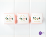 Three pink favor boxes with square floral and gold thank you stickers affixed. Lux Party logo.