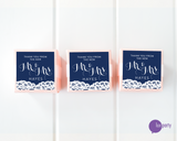 Three pink favor boxes with square navy blue and white lace Mr. & Mrs. wedding stickers affixed. Lux Party logo.