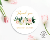 Lux Party's round thank you sticker with pastel flowers and gold text, surrounded by pink tulips.
