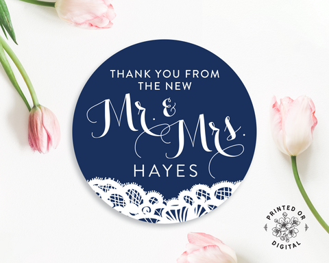 Lux Party's round navy blue Mr. & Mrs. wedding sticker with white text and white lace detail, surrounded by pink tulips.