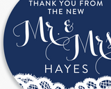 Close up of Lux Party's round navy blue Mr. & Mrs. wedding sticker with white text and white lace detail.