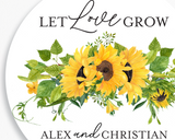 Close up of Lux Party's round let love grow wedding sticker with black text in a sunflower wreath.