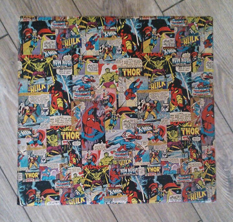 Marvel Stool. With a serious amount of sanding, a lick of paint and transferring a marvel collage onto it using the decoupage technique, it has been completely transformed and been given a new lease of life. Could also be used as a little side table