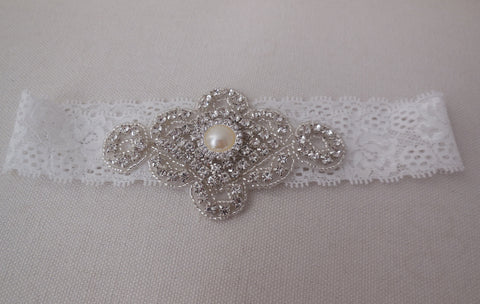 A Bridal wedding rhinestones applique beaded rhinestones motif applique on a elastic lace band is for sale. sold by per piece