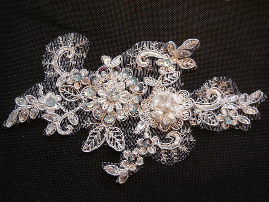 An ivory sequins beaded floral lace Applique / bridal wedding ivory beaded lace motif is for sale Sold by per piece