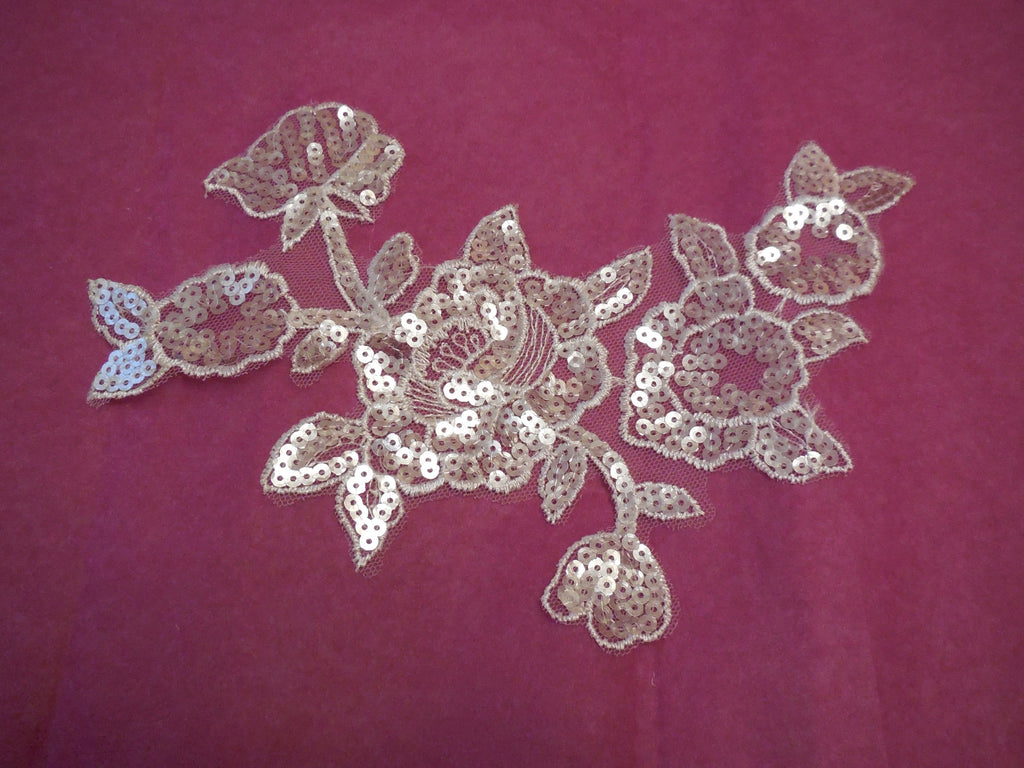 An Ivory bridal sequins floral lace Applique / bridal wedding ivory floral lace motif is for sale. Sold by per piece.