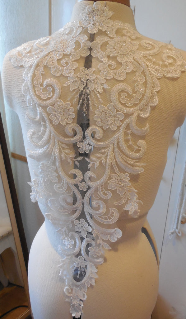 A large piece of ivory floral beaded lace applique bridal wedding bolero lace motif is for sale. Sold by per piece.