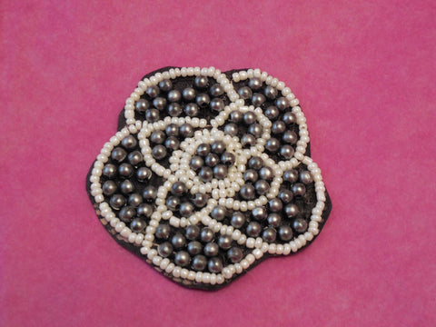 A Small piece of Ivory, grey & black  beaded floral applique /  black beaded lace motif is for sale. sold by per piece