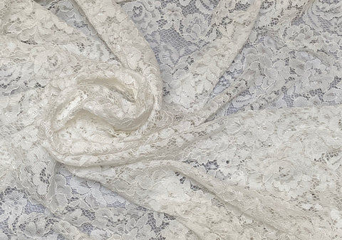 A sheet of ivory floral embroidered lace fabric ivory bridal polyester cotton lace fabric in 200cm X140cm