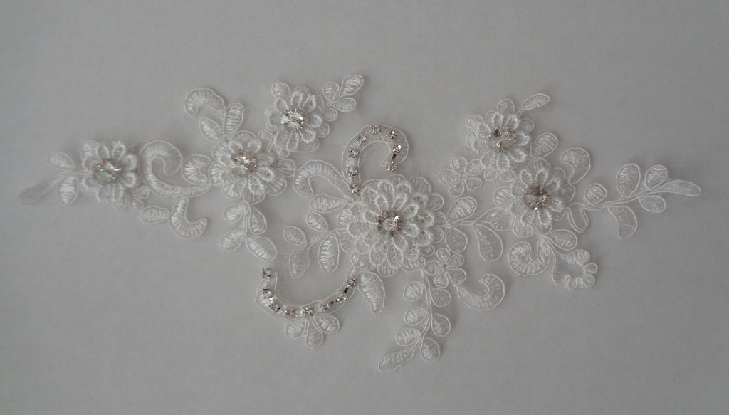 An ivory beaded rhinestones lace applique bridal wedding floral beads lace motif is for sale. Sold by per piece