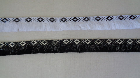 A Black or white braid trim edging sewing trim / jacket coat trimming is for sale. Sold by Per Yard  90cm