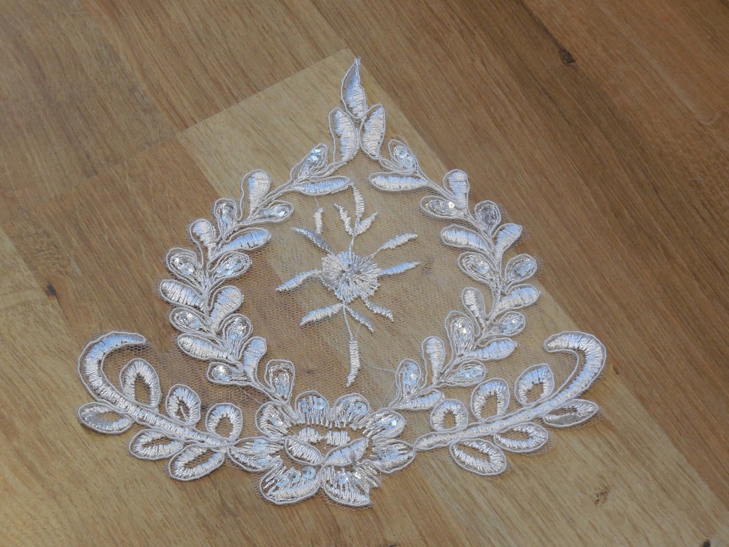 Ivory bridal wedding floral sequins lace applique / ivory gloves lace motif is for sale. Sold by per piece