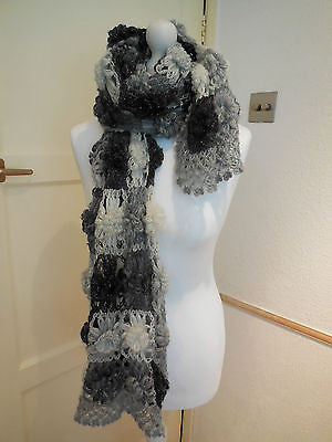 A black,white&grey tone handmade crochet floral women's scarf/shawl is for sale.