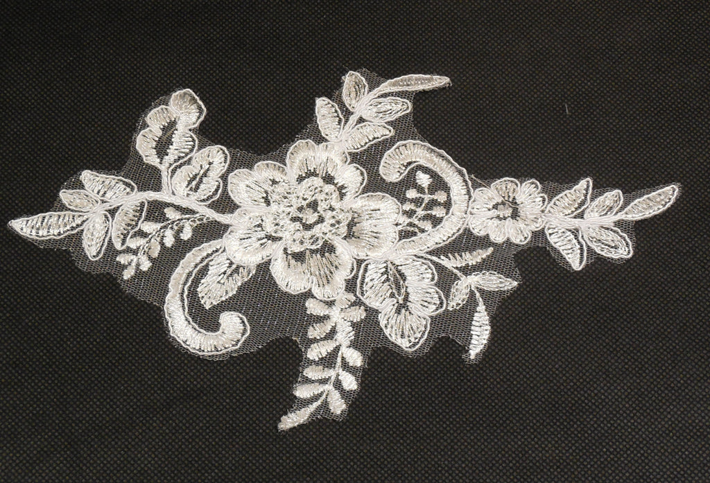 A piece of white or ivory floral lace applique / bridal wedding tulle lace motif is for sale. Sold by per piece