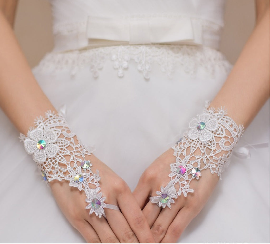 a pair of ivory rainbow beaded wedding lace gloves / bridal floral lace gloves is for sale. Sold By pair