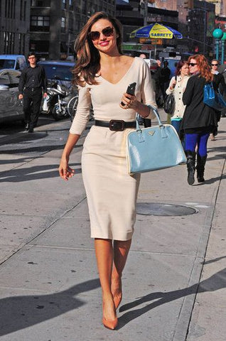Miranda Kerr in Nude Neutral wardrobe clothes with bright bag