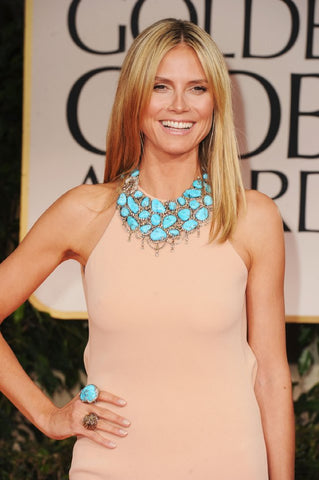 Heidi Klum in Nude neutral dress wardrobe with chunky blue jewelry necklace