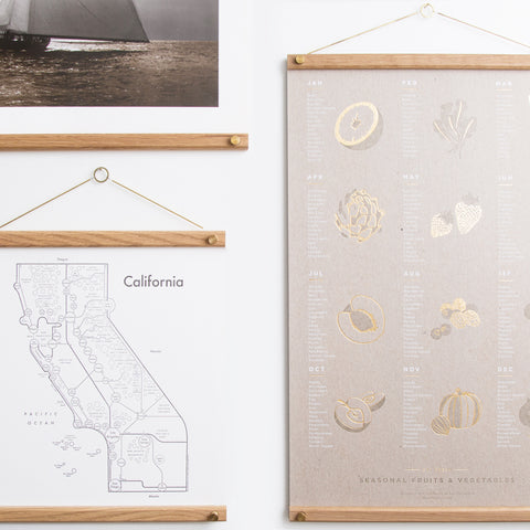 hanger frames for wall mounting pictures - shown with pictures and hanging on wall; made in usa by 2nd shift design company | carpenter hill